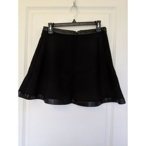 Black winter flare skirt with faux leather trim.